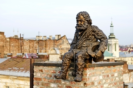 19944647-lvov-ukraine--april-24-2013-sculpture-a-chimney-sweep-on-the-roof-of-the-house-of-legends-on-april-2